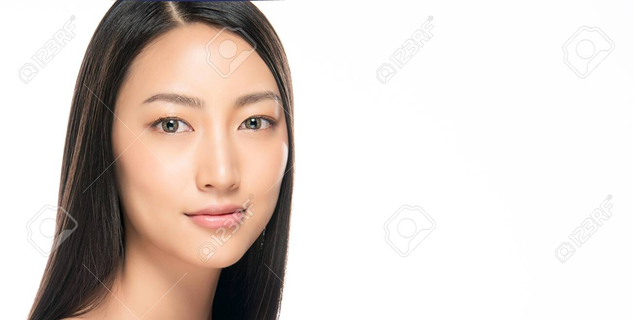 Beautiful Young Woman with Clean Fresh Skin. Face care . Facial treatment . Cosmetology , beauty and spa. Asian women portrait - 122673859