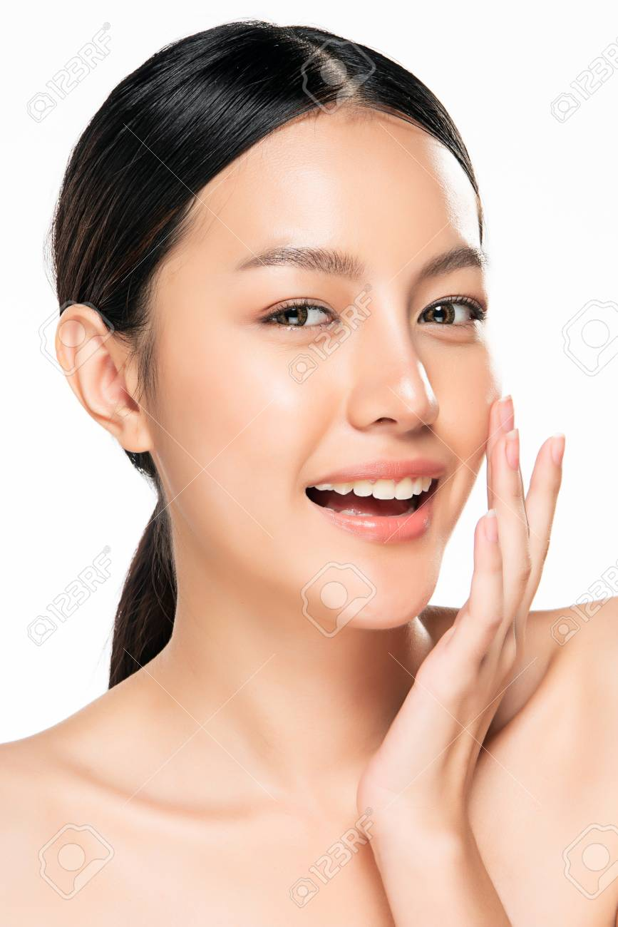 Beautiful Young asian Woman with Clean Fresh Skin look. Beautiful face and skin. Facial treatment. Cosmetology, beauty and spa. - 123986078