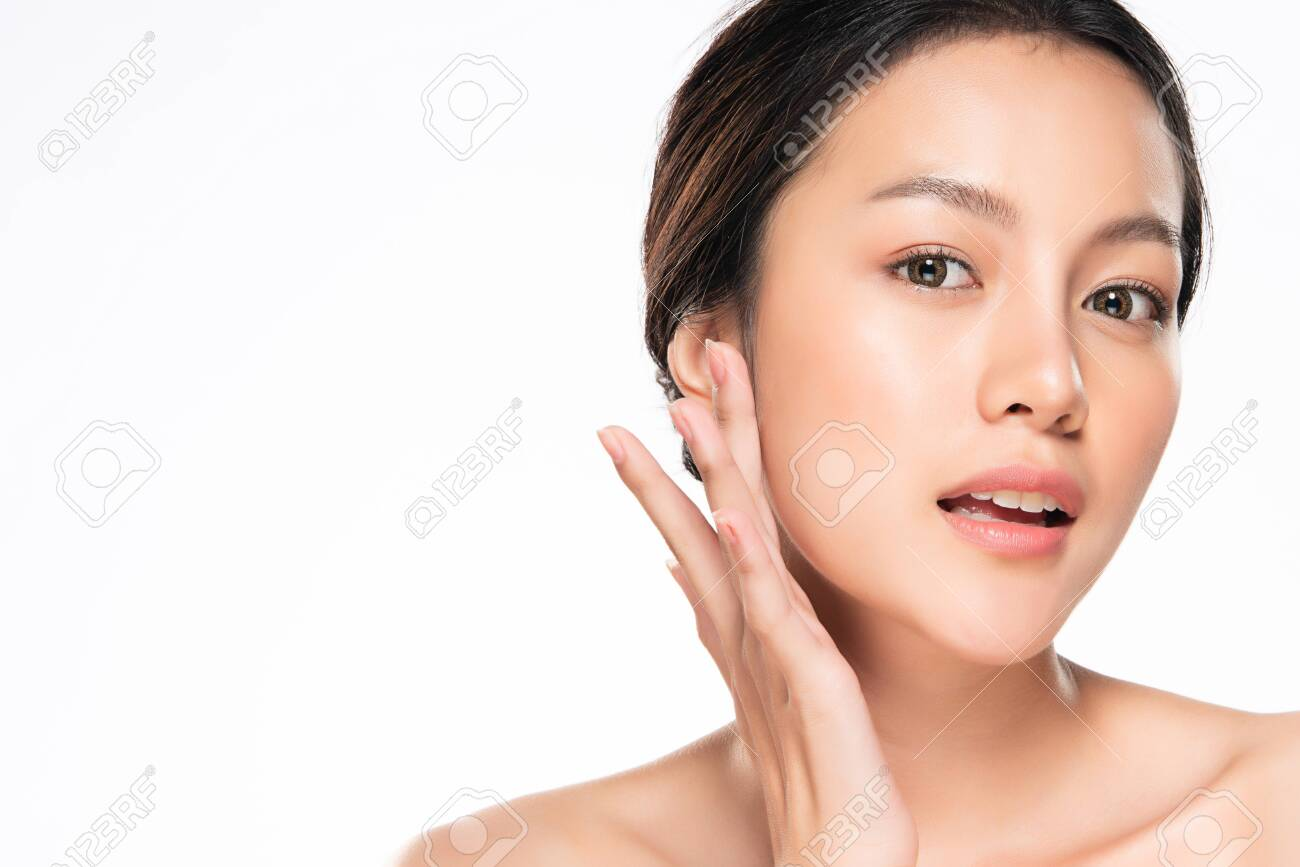 Beautiful Young Asian Woman with Clean Fresh Skin touch own face - 129668475