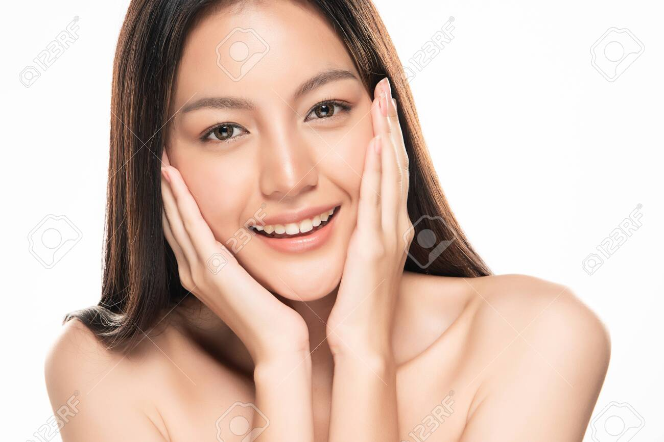 Beautiful young Asian woman touching soft cheek and smile with clean and fresh skin. Happiness and cheerful with, isolated on white background, Beauty and Cosmetics Concept, - 134030465