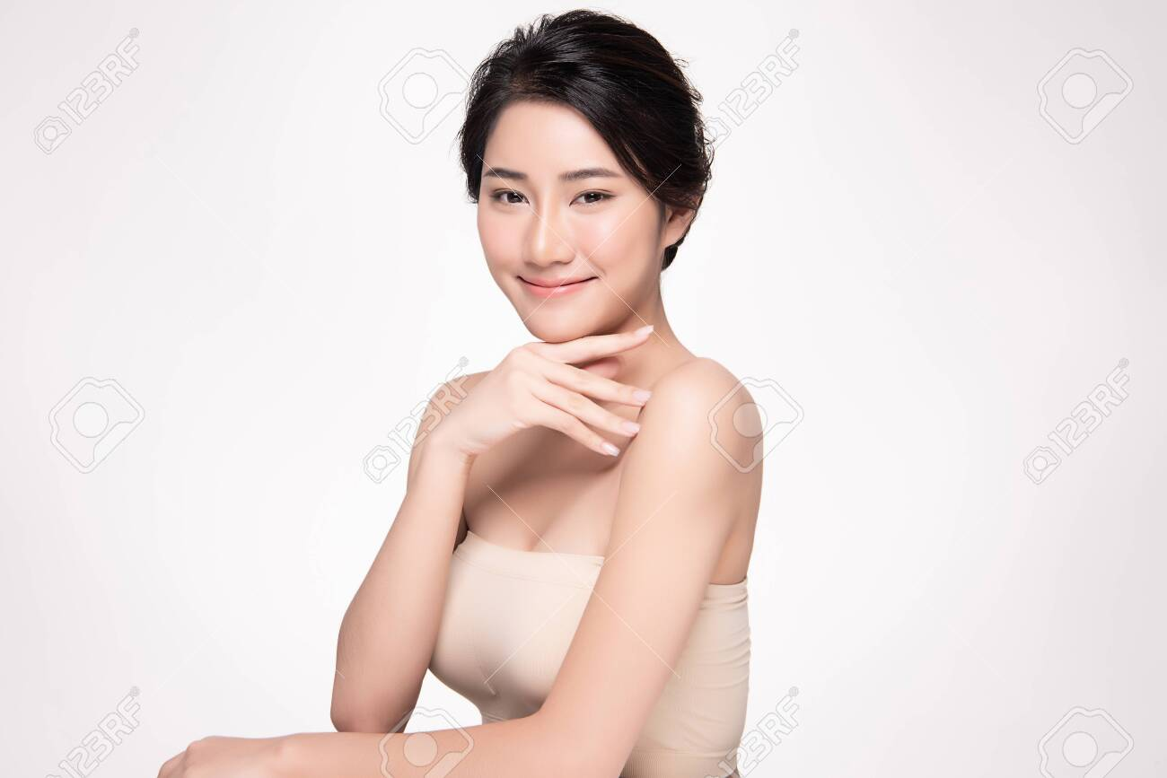 Beautiful young Asian woman touching soft cheek and smile with clean and fresh skin. Happiness and cheerful with, isolated on white background, Beauty and Cosmetics Concept, - 133957142