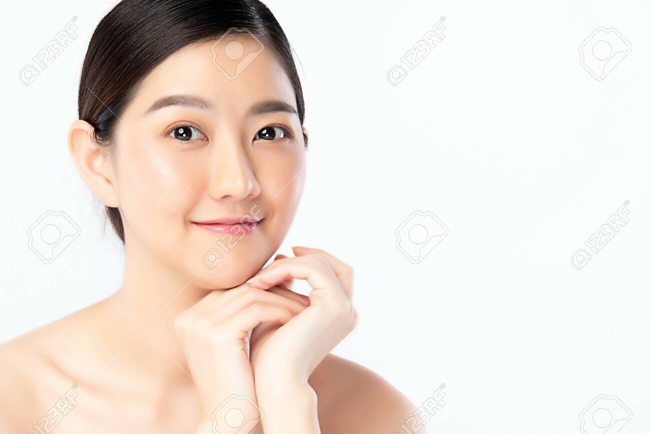 Beautiful Young Asian Woman with Clean Fresh Skin. Face care, Facial treatment, Cosmetology, beauty and healthy skin and cosmetic concept .woman beauty skin isolated on white background. - 142938467