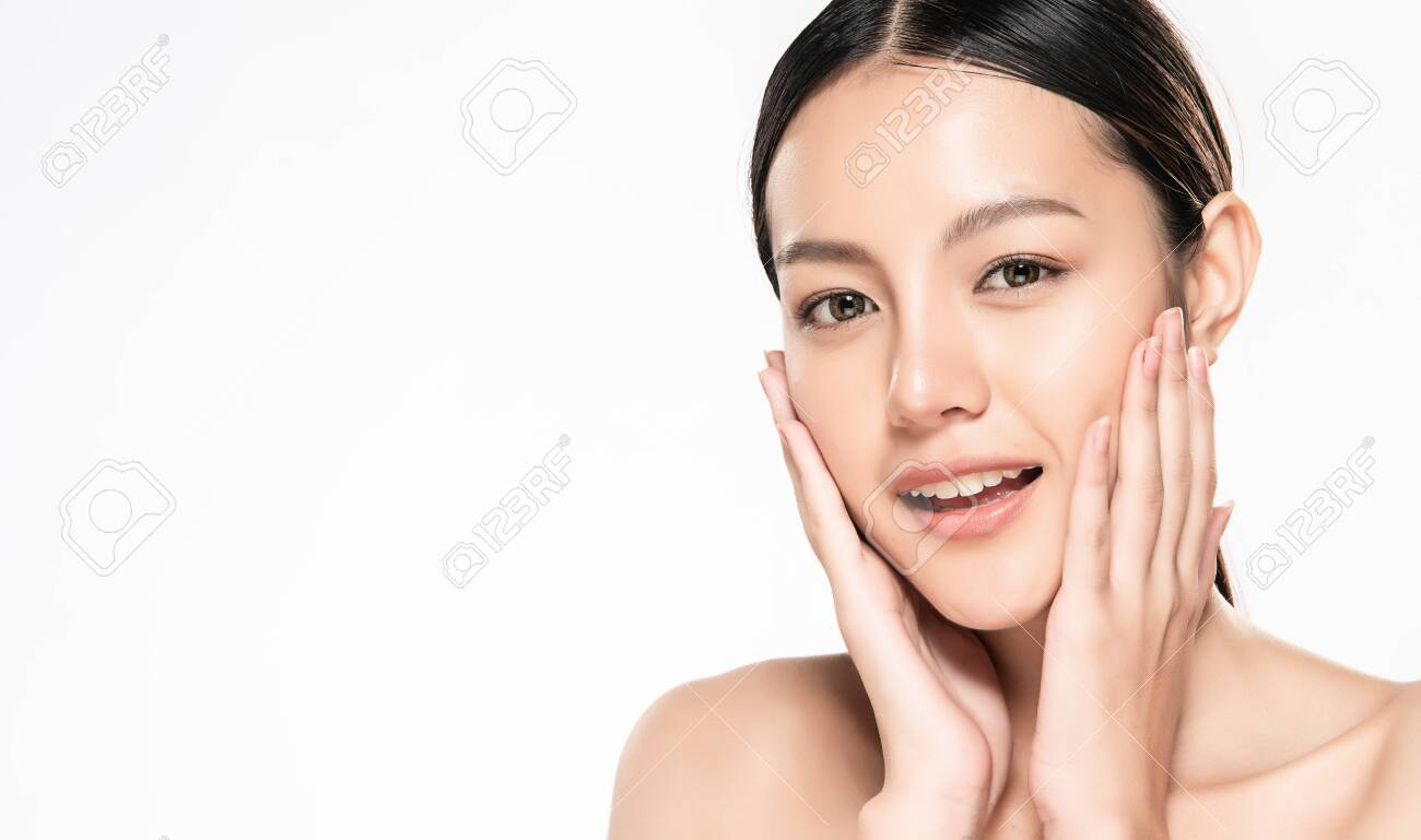 Beautiful Young asian Woman touching her clean face with fresh Healthy Skin, isolated on white background, Beauty Cosmetics and Facial treatment Concept. - 147951663