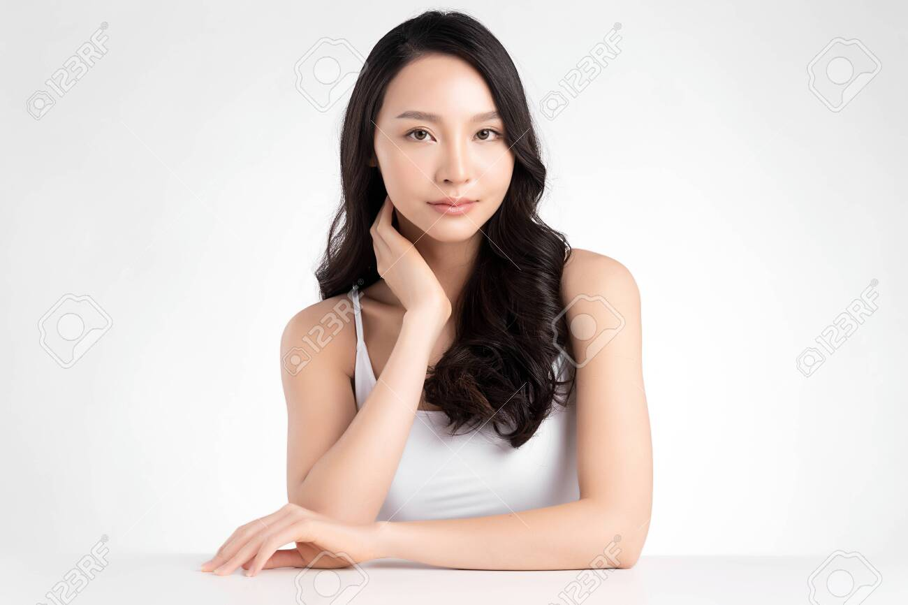 Beautiful Young asian Woman with Clean Fresh Skin, on white background, Face care, Facial treatment. Cosmetology, beauty and spa. Asian women portrait - 153254970