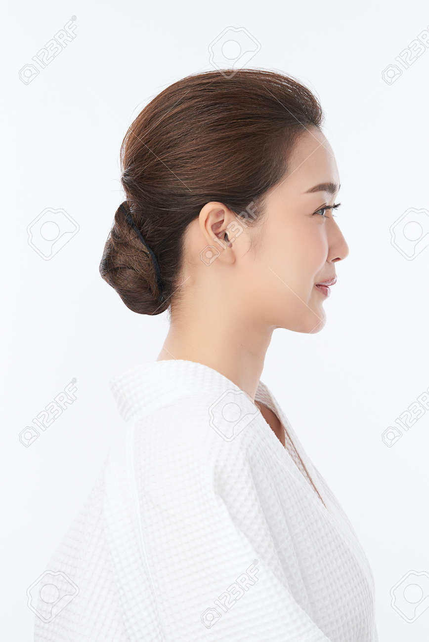 Beautiful young Asian woman wearing bathrobe on white background, Face care, Facial treatment, Cosmetology, beauty and spa Concept. - 168228135