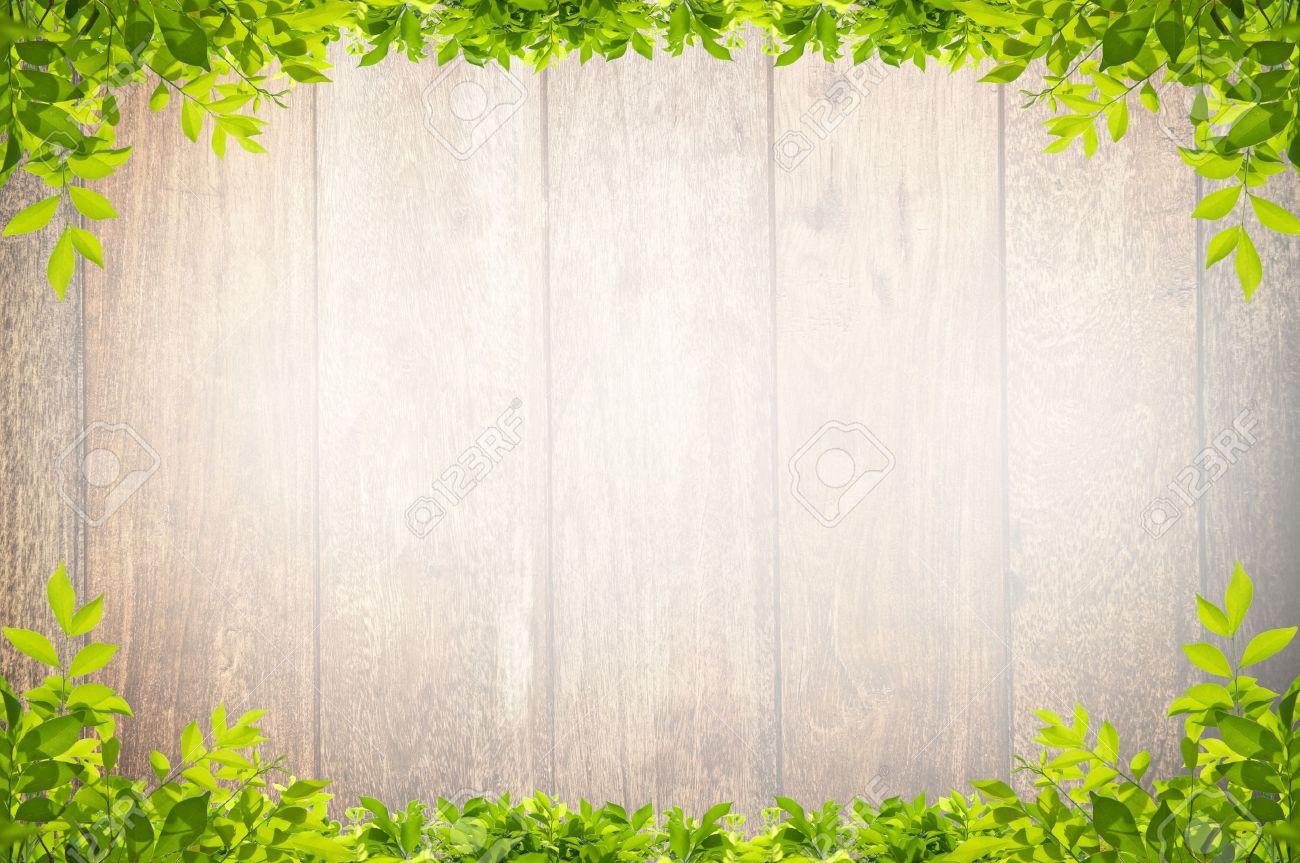 leaves frame on wooden background - 17066806