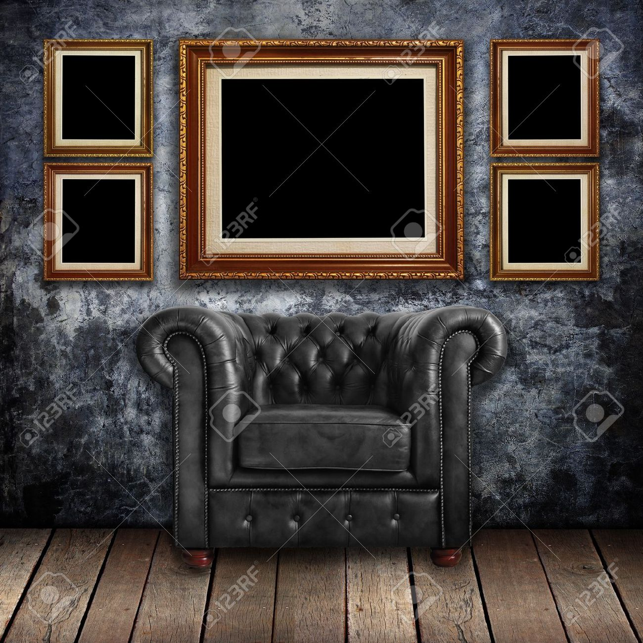 edcd00ca026 Grungy wall with Classic Brown leather armchair and gold frames background  Stock Photo - 12801664
