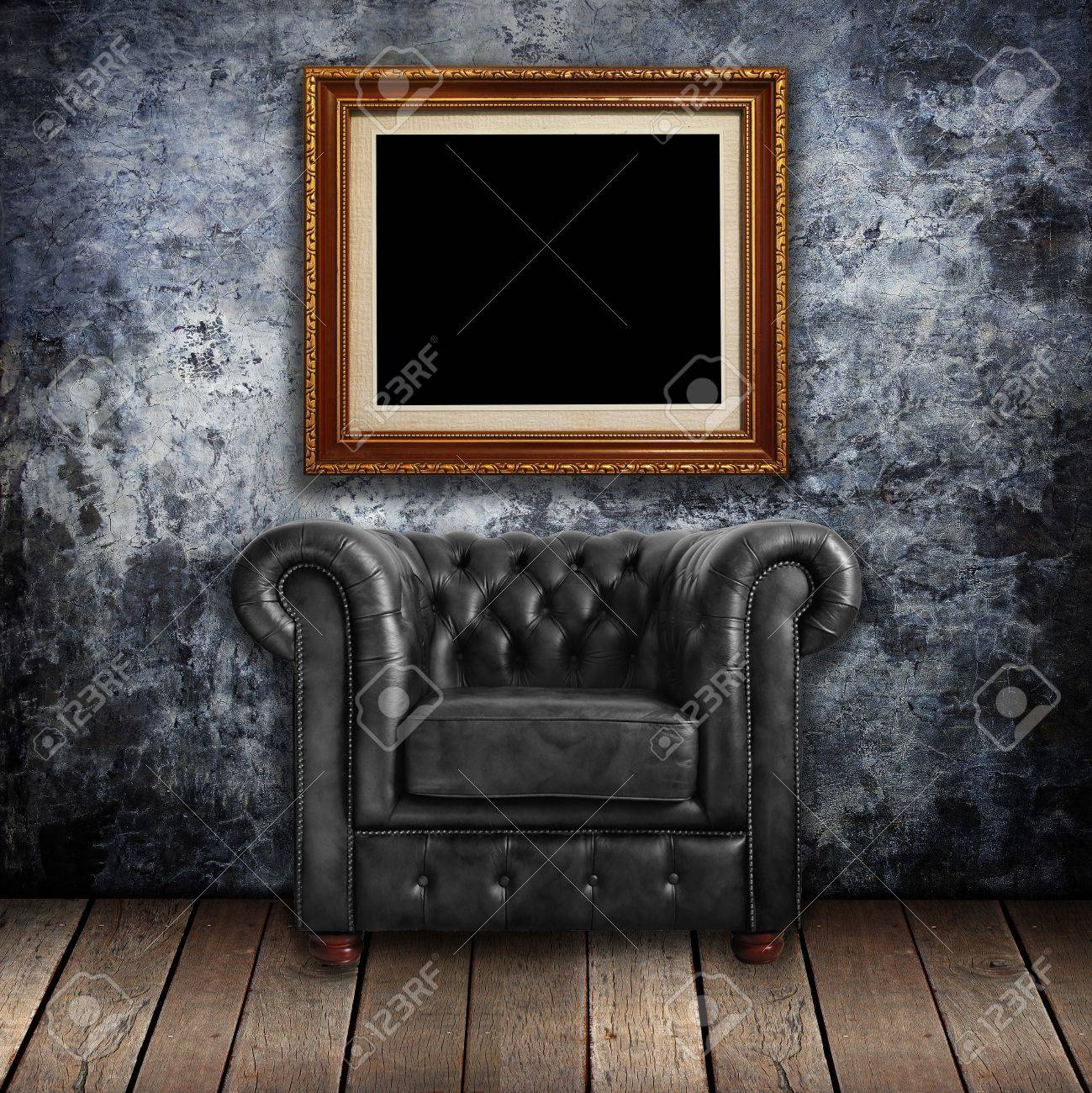 df8453b34d7 Grungy wall with Classic Brown leather armchair and gold frames background  Stock Photo - 12801665