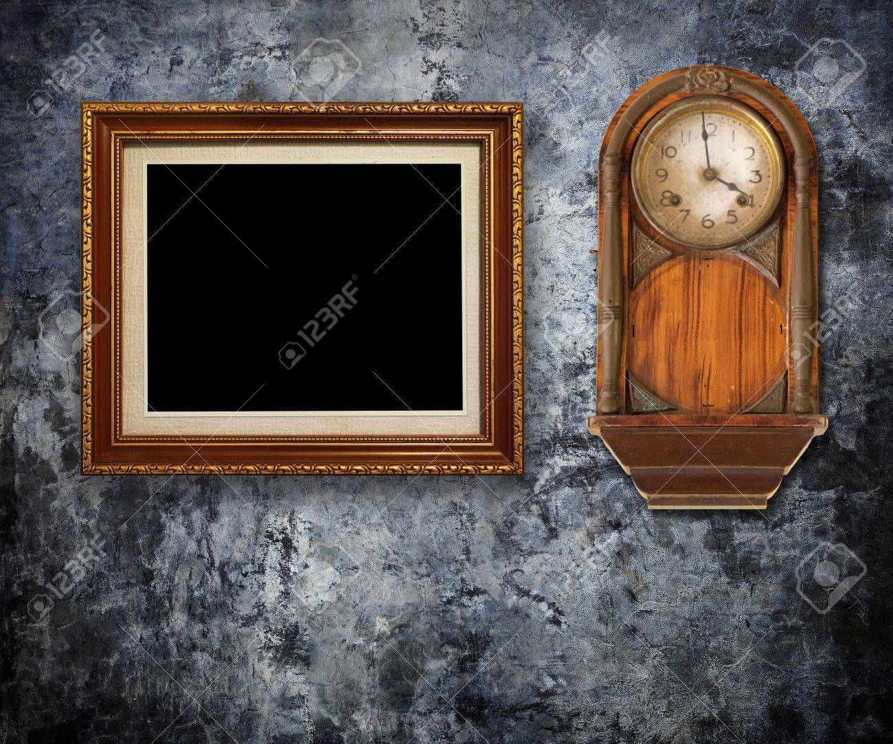 f577ca25d5b Vintage clock with Gold frames on Grungy wall Stock Photo - 15196206