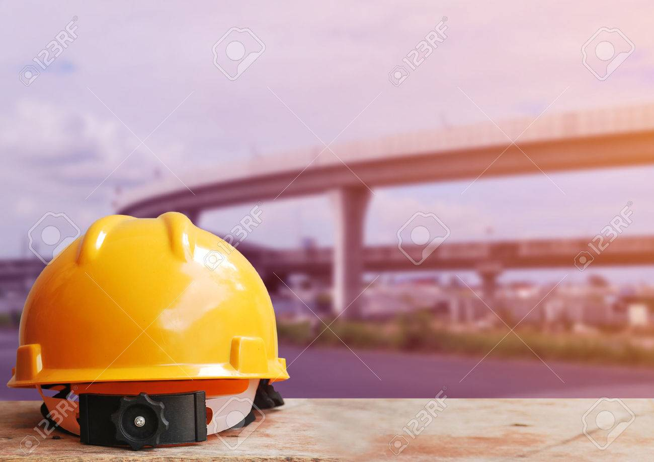 safety helmet with highway construction site background stock photo
