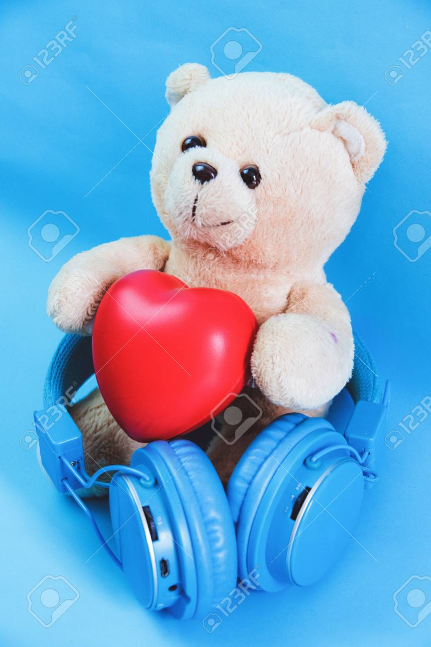 Little teddy bear , a valentine's gift for lover isolated on light blue background Stock Photo