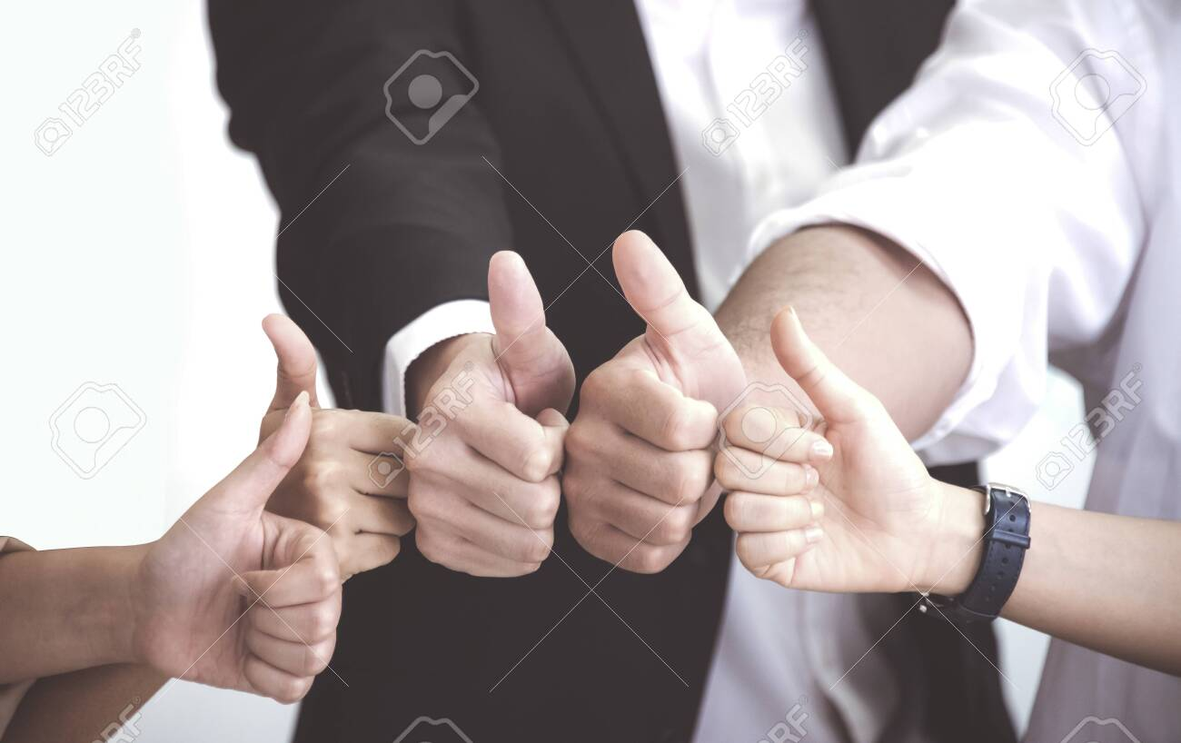 Business People with thumb up after meeting about new normal planning at office - 153391954