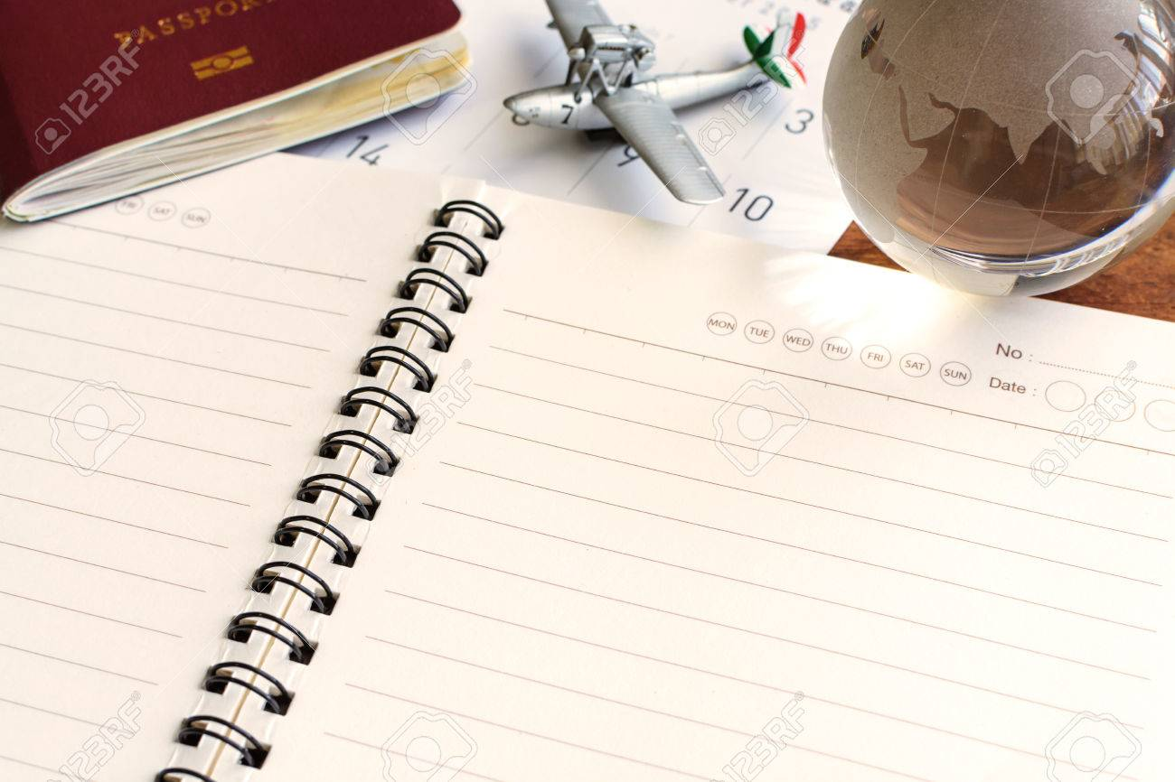 Open Diary And Calendar With Passport, Travel Planning Stock Photo ...