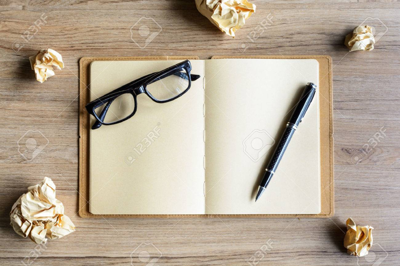 Crumpled Paper Balls With Eye Glasses And Notebook On Wood Desk Creative Writing Concept Stock