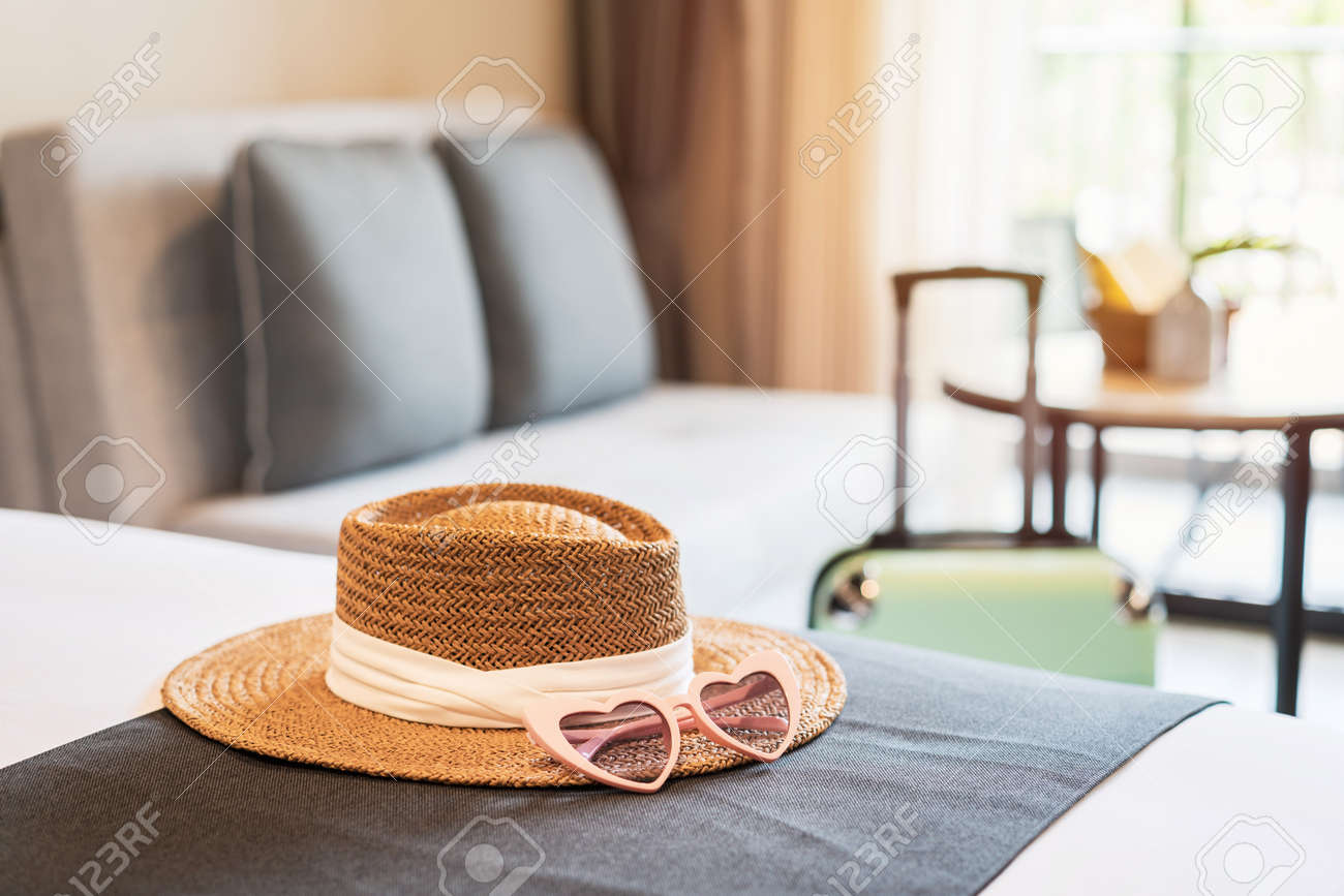 Hat and sunglasses with luggage in hotel room, Travel concept - 158345928