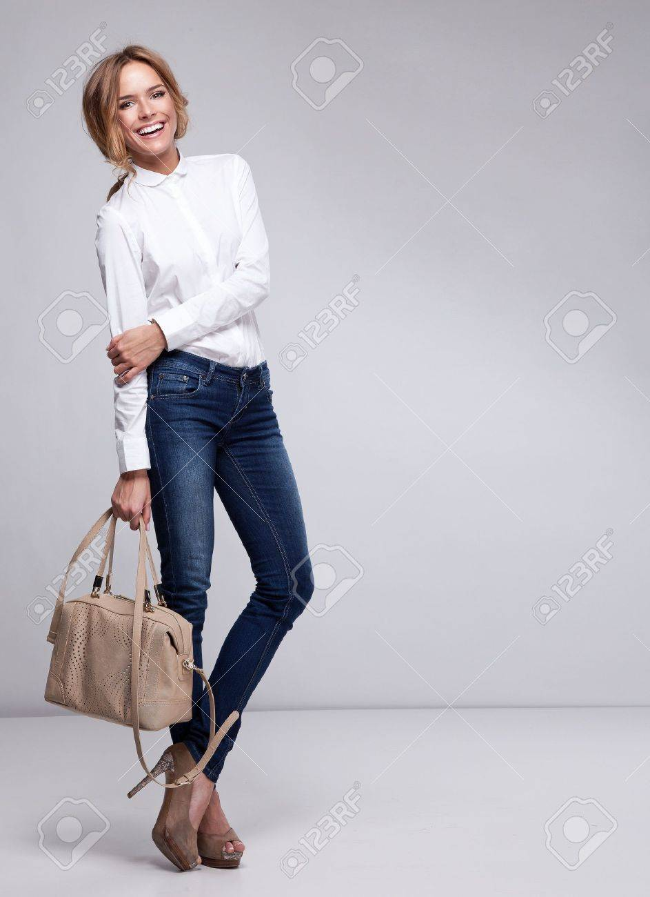 Beautiful woman holding a handbag Stock Photo - 19398790