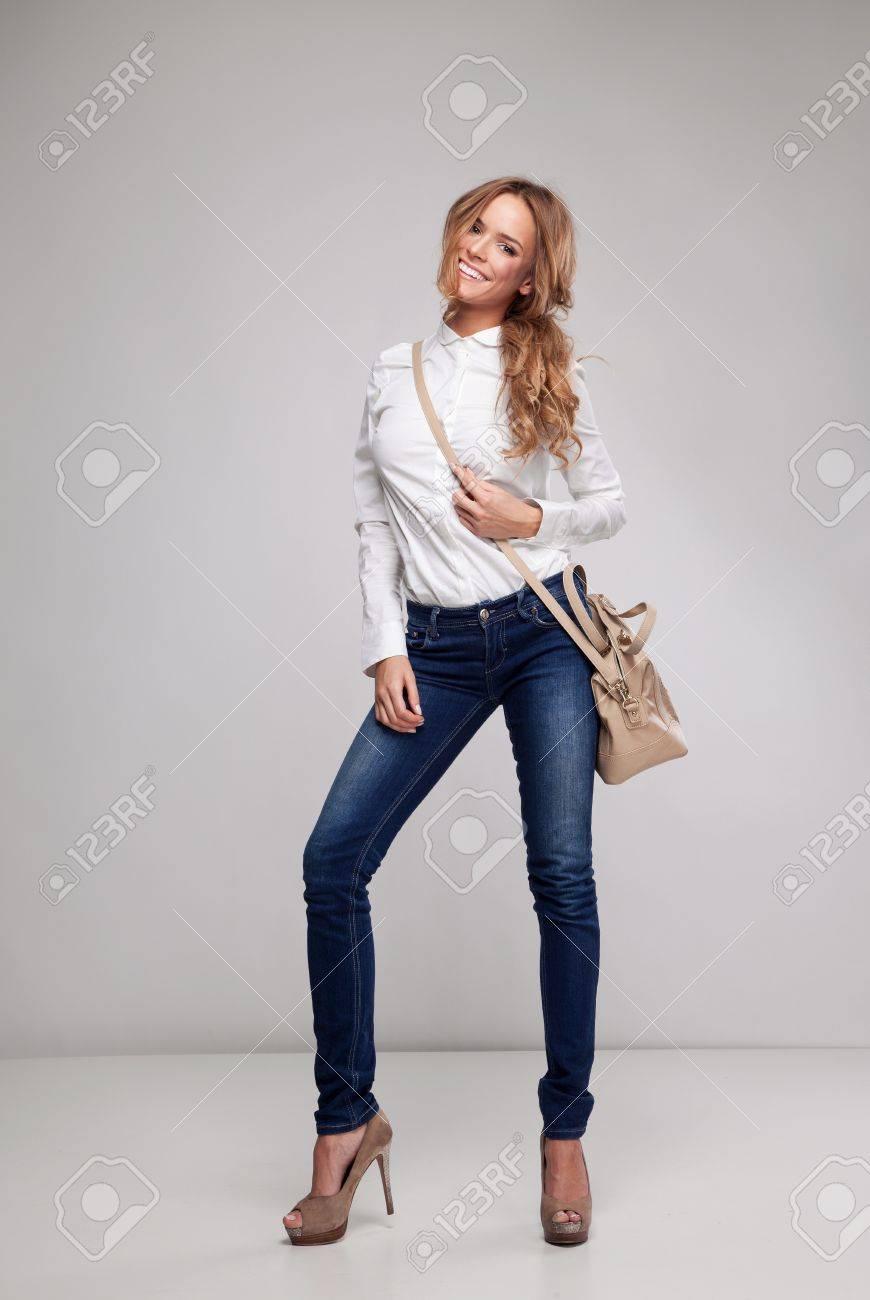 Beautiful woman holding a handbag Stock Photo - 19398789