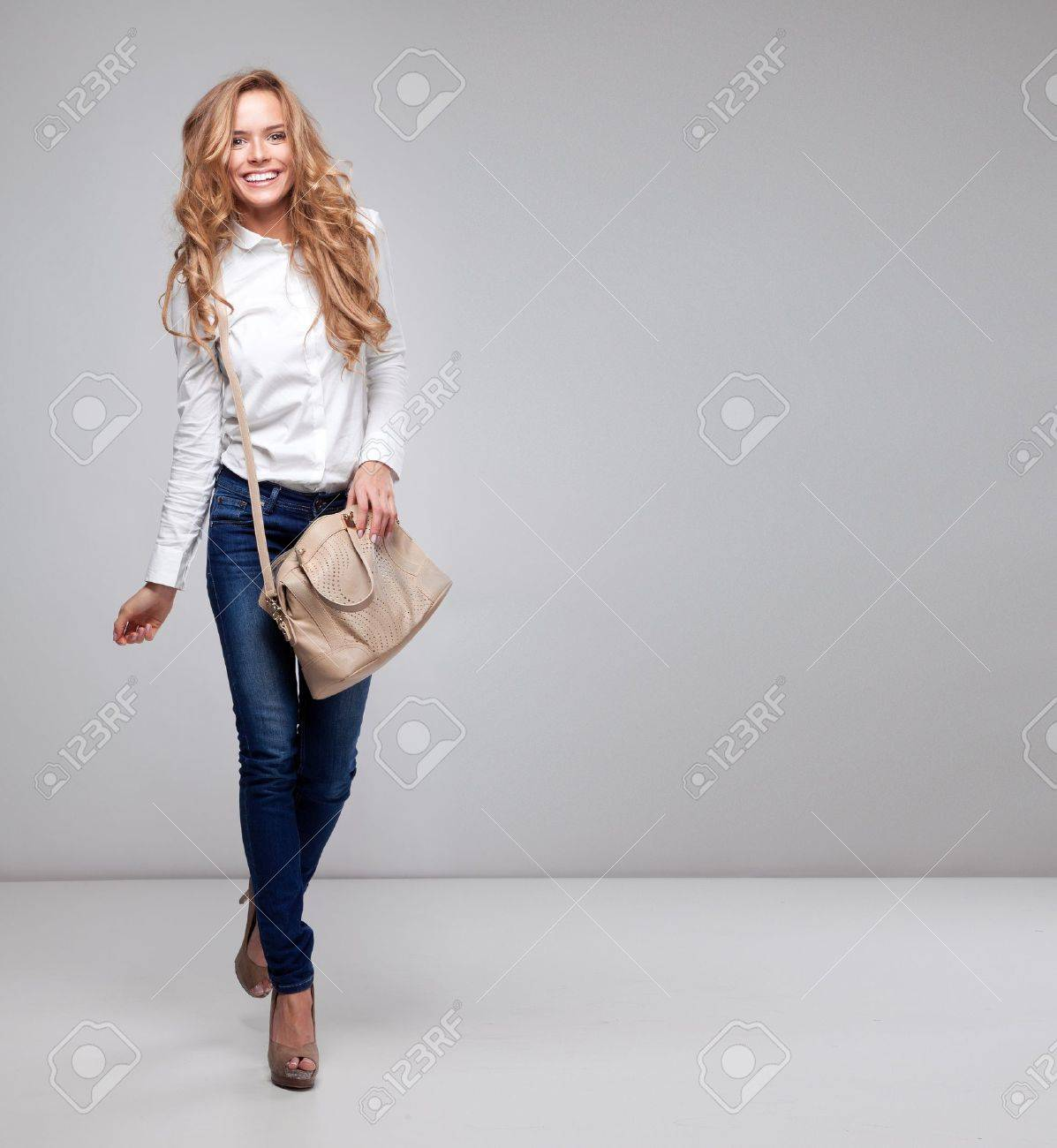Beautiful Woman Holding A Handbag Stock Photo, Picture And Royalty ...
