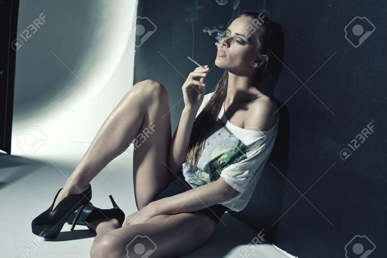 Fashion photo of sexy woman smoking a cigarette Stock Photo - 19754222