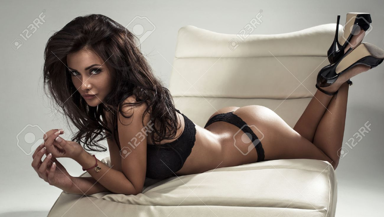 Beautiful Woman Lying On Stomach Stock Photo, Picture And Royalty ...