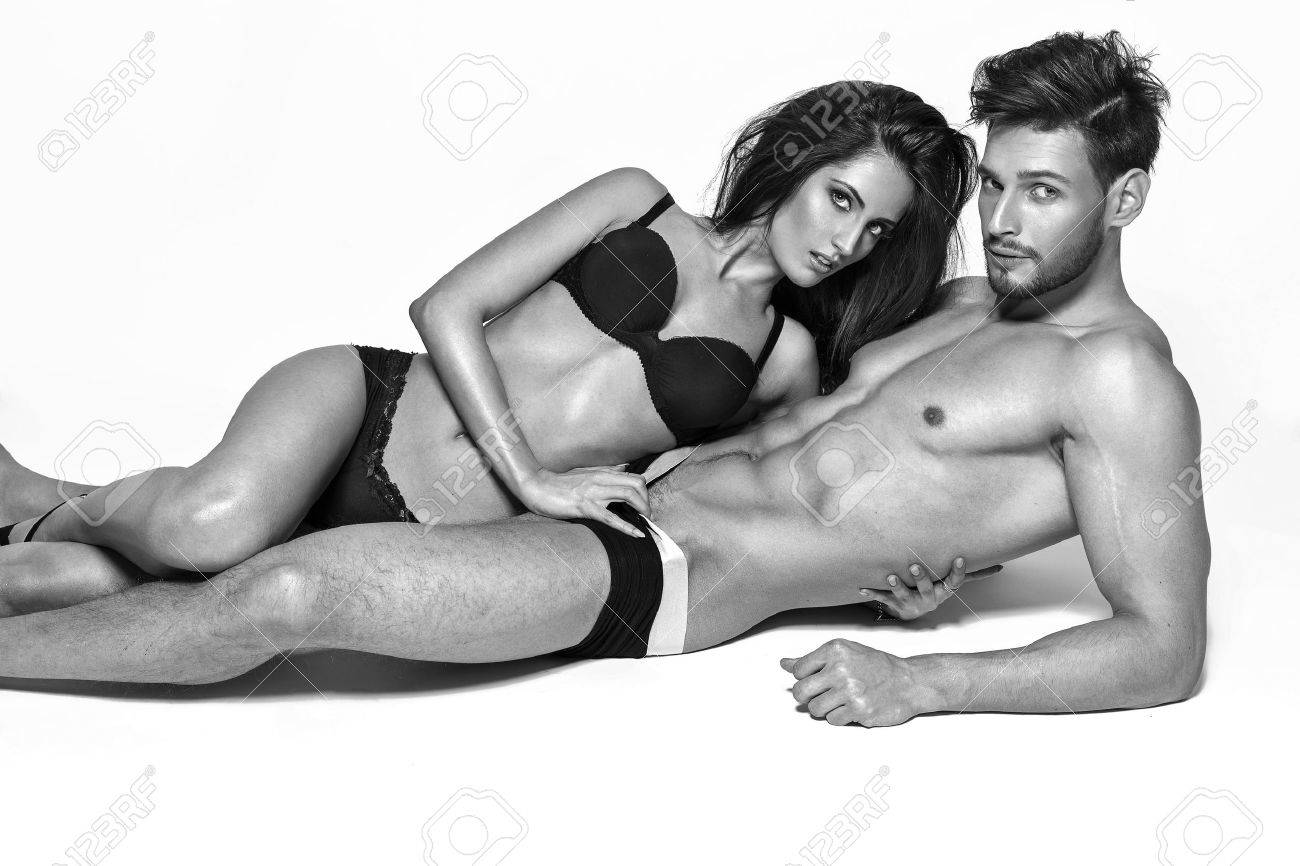 sexy couple posing in underwear stock photo, picture and royalty