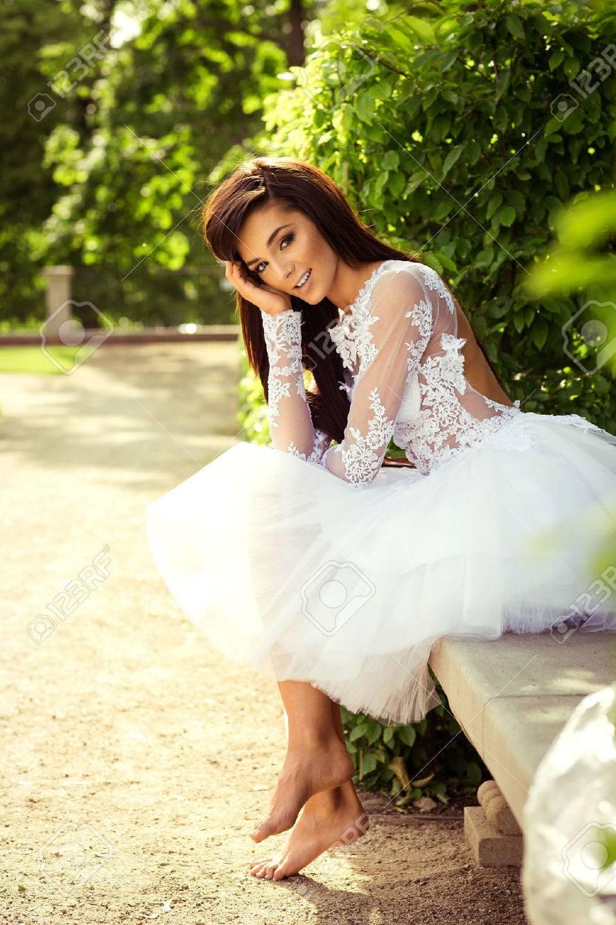 https://previews.123rf.com/images/kiuikson/kiuikson1507/kiuikson150700112/42807915-beautiful-young-bride-sitting-in-the-park.jpg