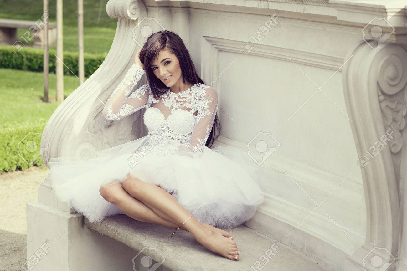 https://previews.123rf.com/images/kiuikson/kiuikson1507/kiuikson150700116/42807933-attractive-happy-woman-in-white-dress-without-shoes-sitting-and-resting.jpg