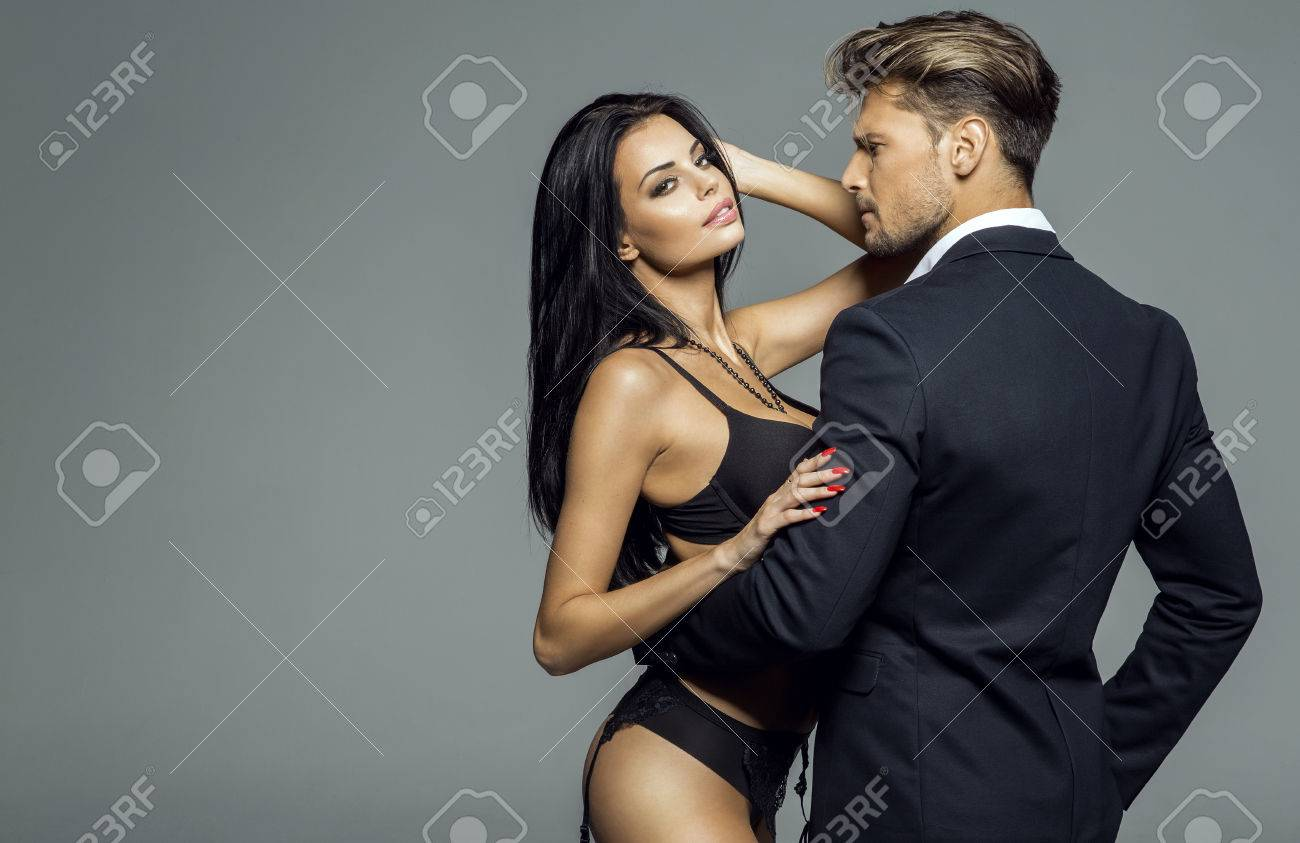 ccb1dec99 Portrait of sexy woman wear lingerie and hugging handsome man in black suit  Stock Photo -