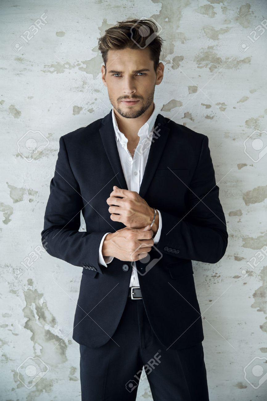 Portrait of man in black suit - 62132275