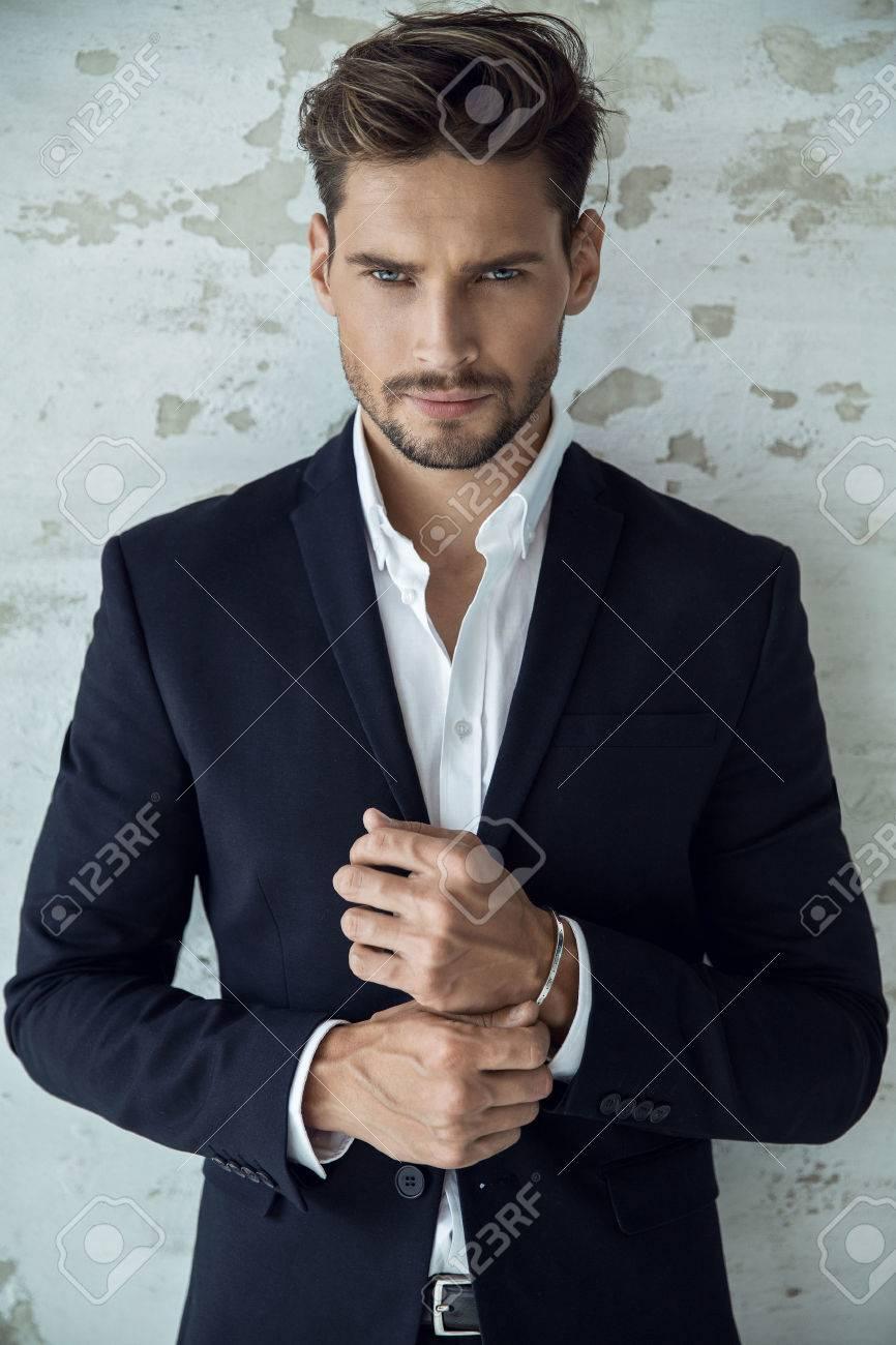Portrait of man in black suit - 62132397