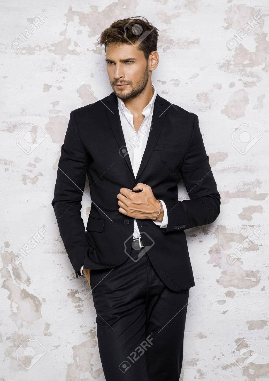 Portrait of man in black suit - 62133271