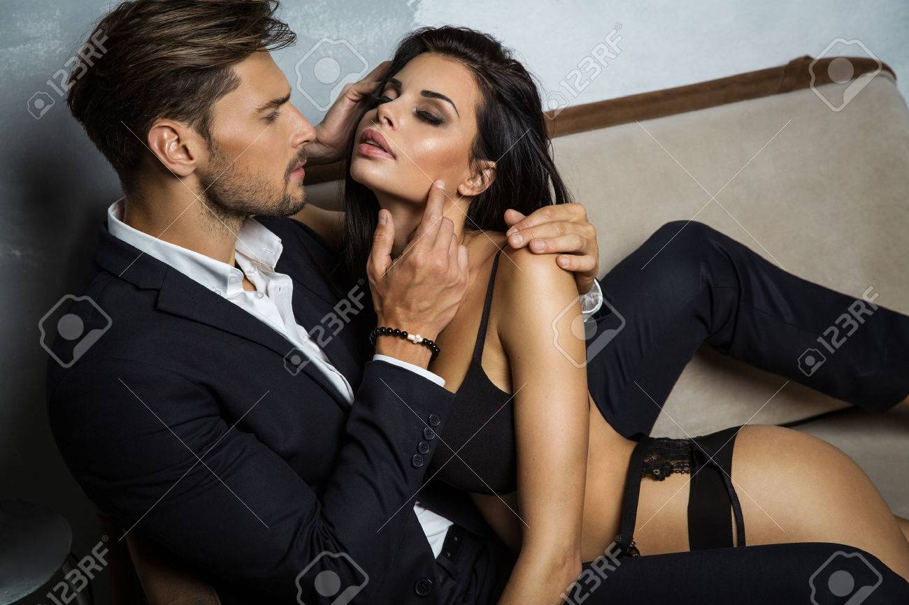 437a334f4 Sexy Couple On Coach Stock Photo, Picture And Royalty Free Image ...