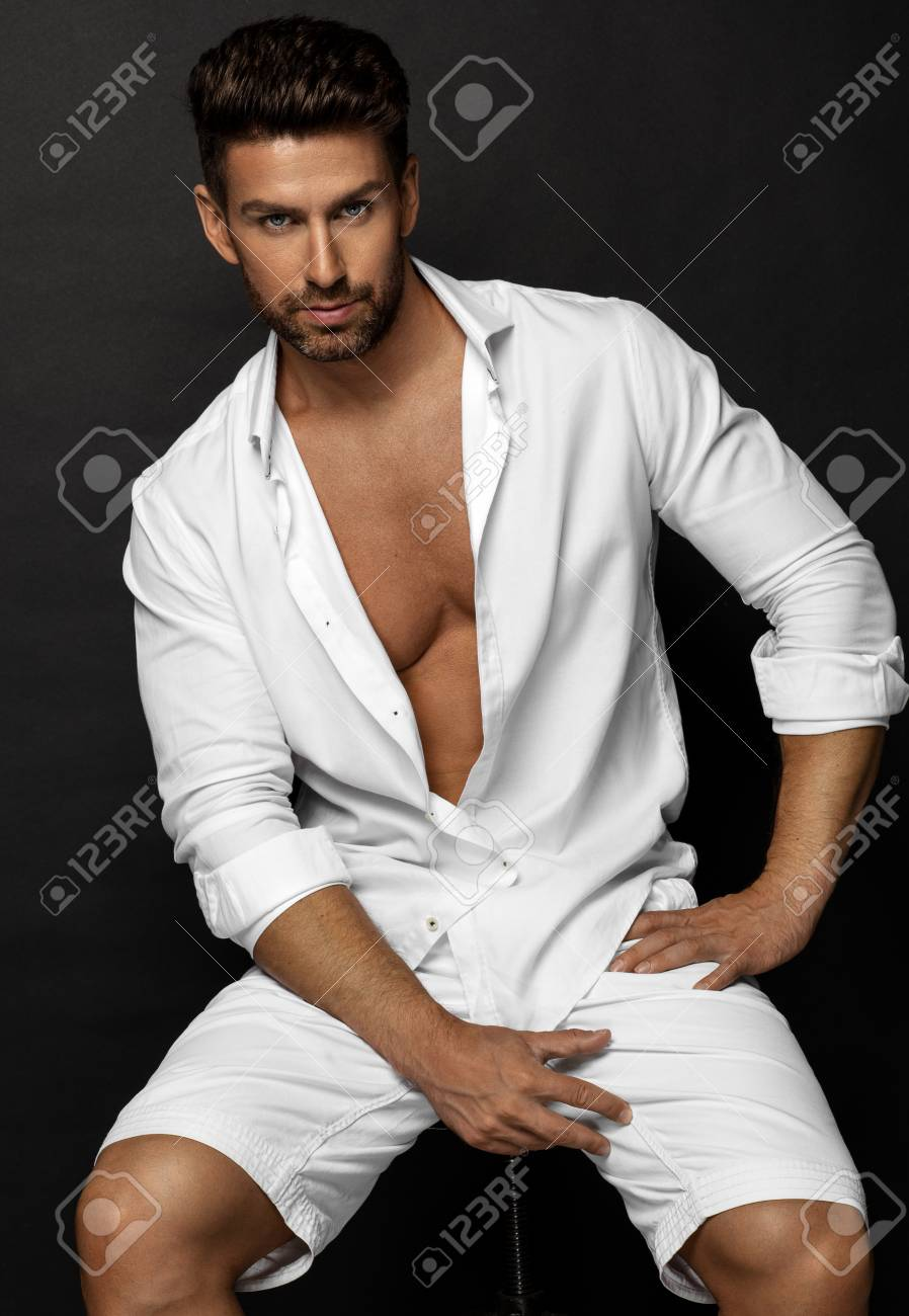 Handsome Male Model Posing In White Stock Photo Picture And Royalty Free Image Image 84918909