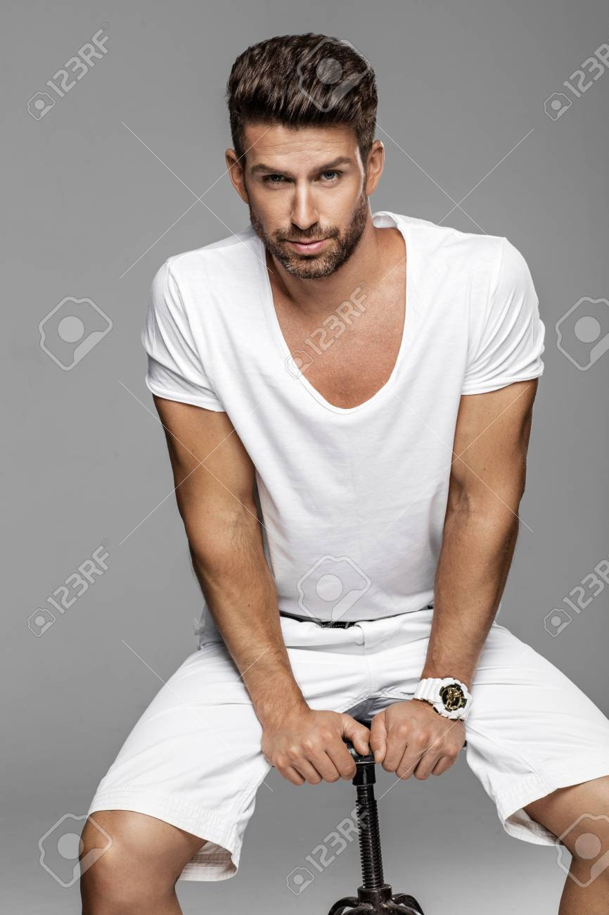 Handsome Male Model Posing In White Stock Photo Picture And Royalty Free Image Image 84918908