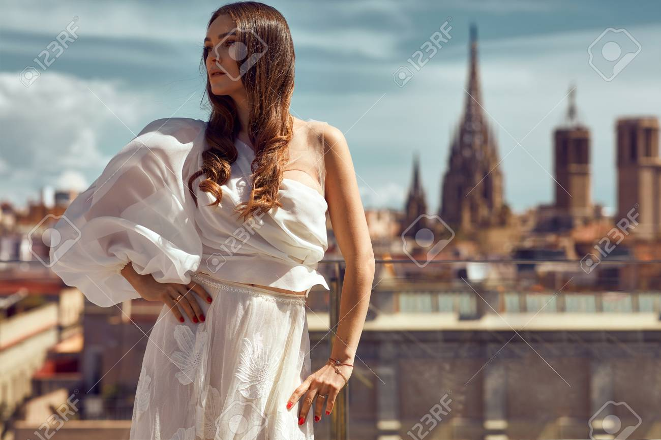 Photo of young female model posing outdoor on urban scenery - 123800843