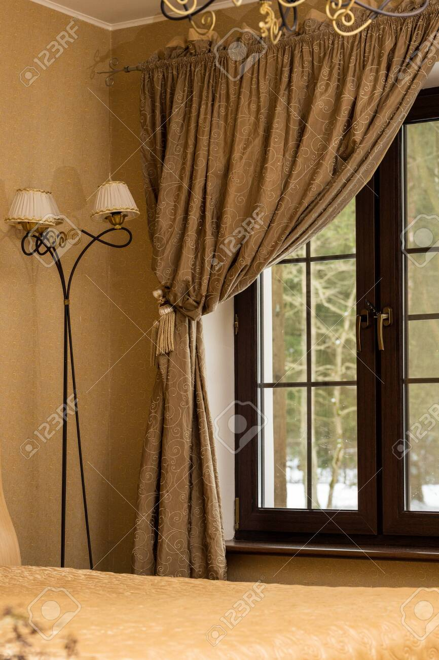 Vintage Decor Of A Rustic Bedroom In Warm Colors Bed Lamp And Stock Photo Picture And Royalty Free Image Image 140668031