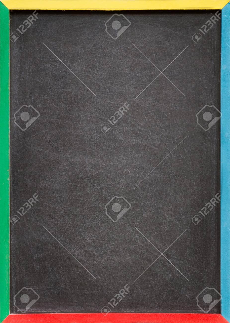 a blank slightly dirty chalkboard blackboard in a colourful old wooden frame stock photo