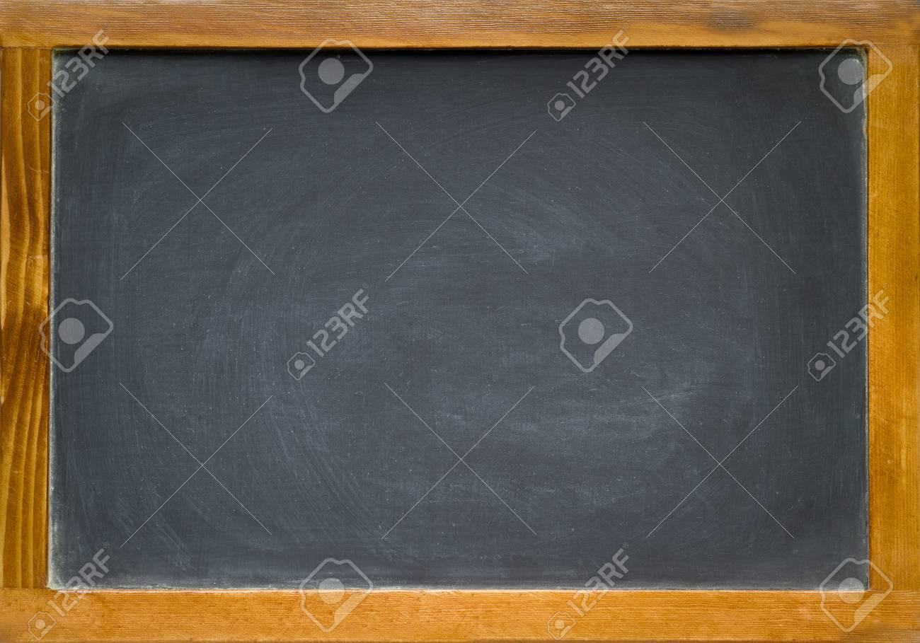 a blank slightly dirty chalkboard blackboard in an old wooden frame stock photo 37244249