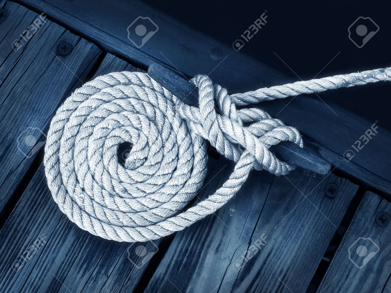 boat rope tied to dock securing boat Stock Photo - 339498