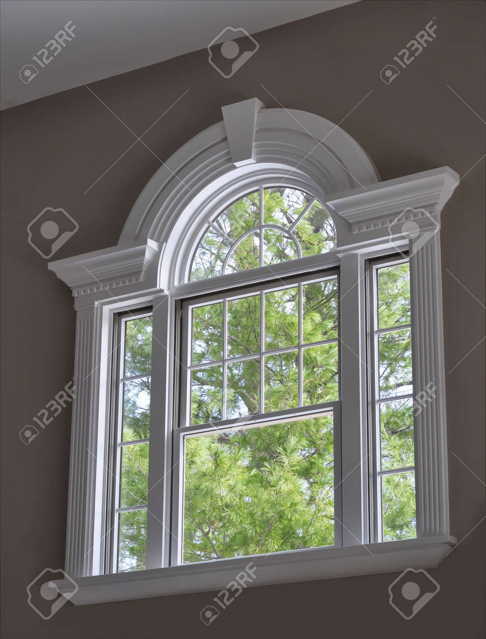Arched Crown Moulding Arched Window With Ornate Molding Stock Photo Picture And Royalty