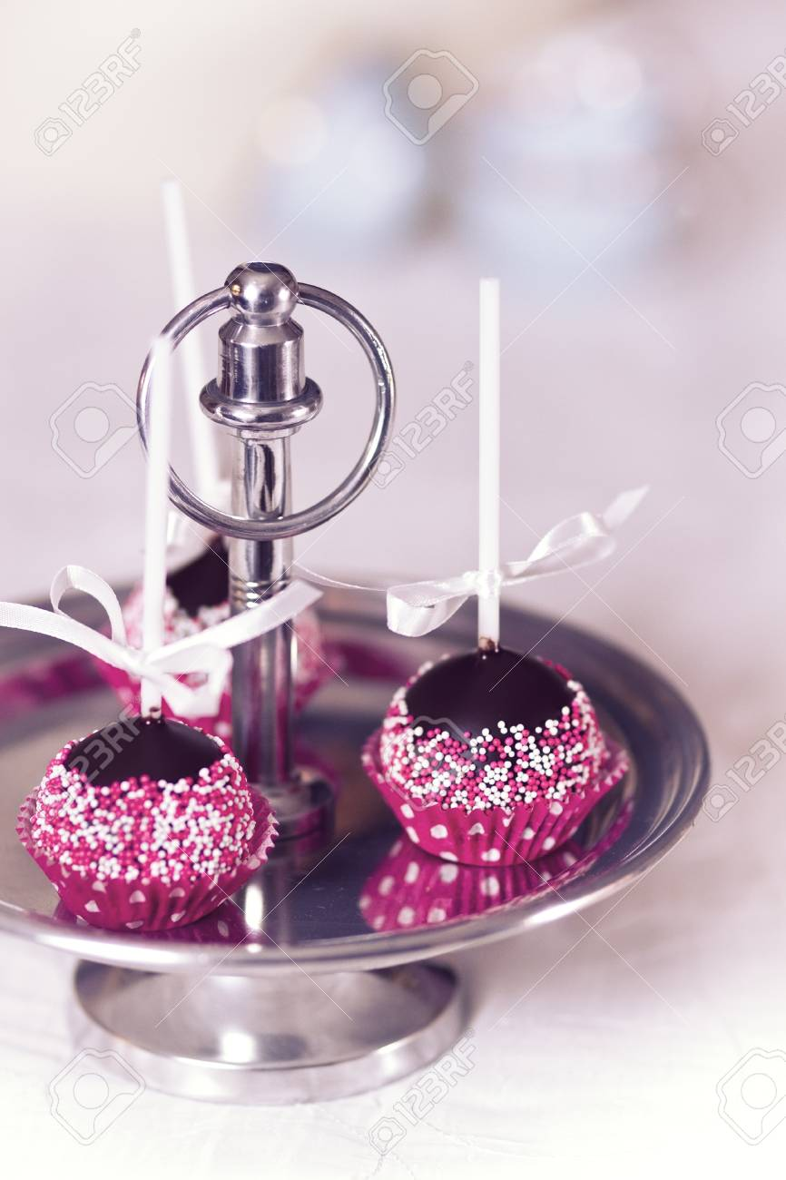 Chocolate cake pop decorated with pink and white sugar sprinkles Stock Photo - 19199041
