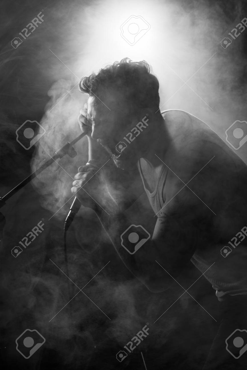 Young man playing rock concert  sings and play guitar Stock Photo - 19200166