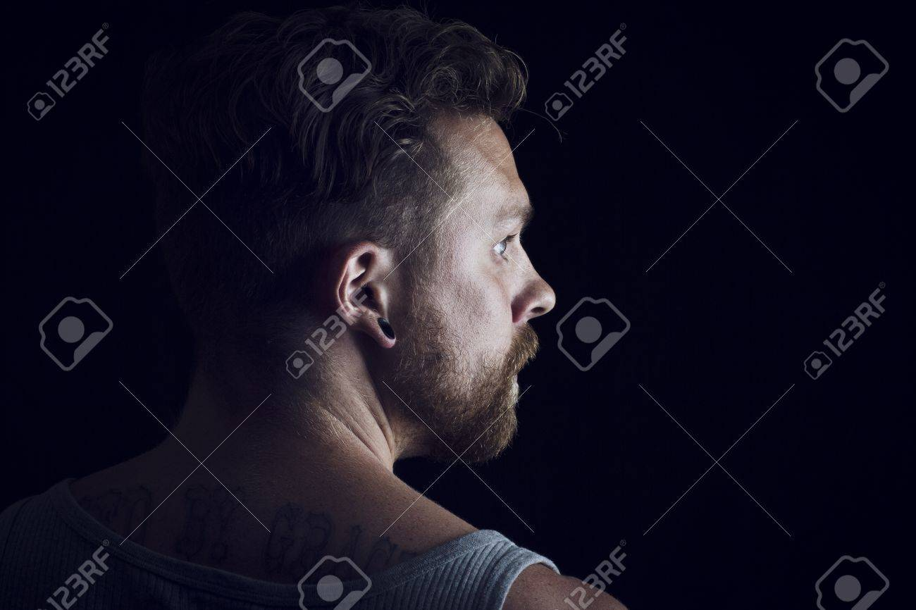 Thinking young man   rocker with ear rings Stock Photo - 19200382