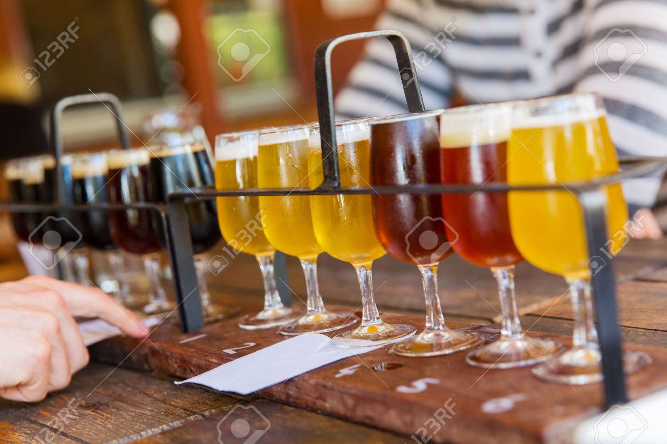 Tasting of many different types of beers. Stock Photo - 27642416