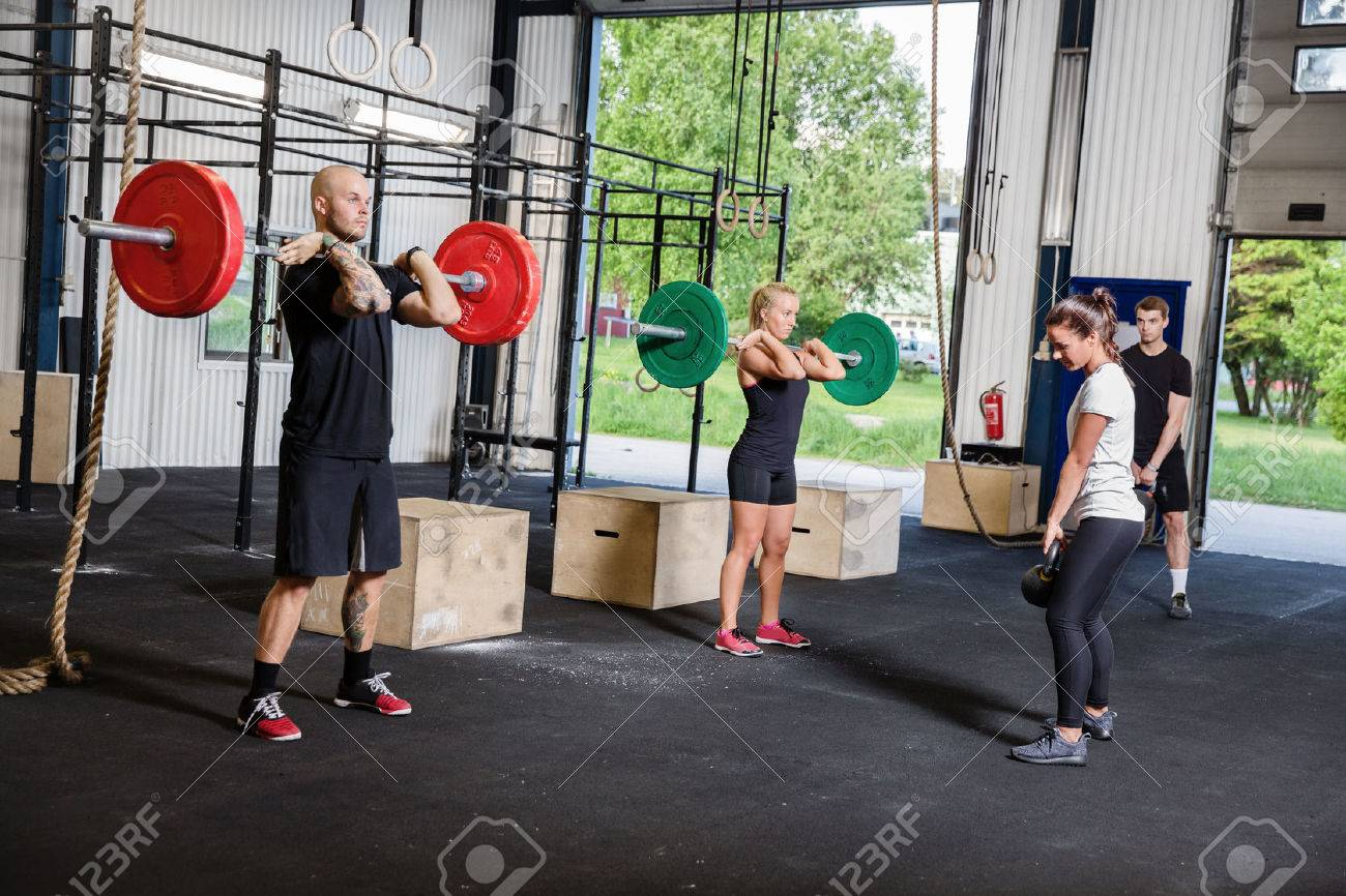 A group trains at a cross fit center  Weight workout at the gym Stock Photo - 29283231