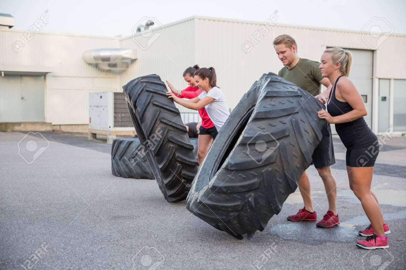 A group or team flipping heavy tires outdoor. Stock Photo - 29285960