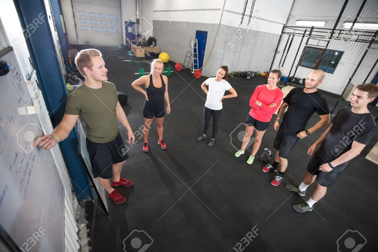A instructor going through today's training plan at fitness gym. Stock Photo - 29285969