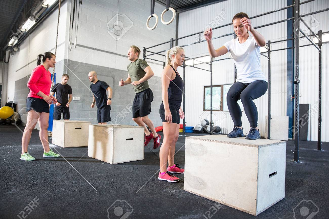 Crossfit group trains box jumps Stock Photo - 29841837