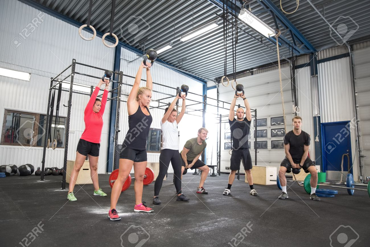 Team workout with kettlebells at fitness gym Stock Photo - 29652573