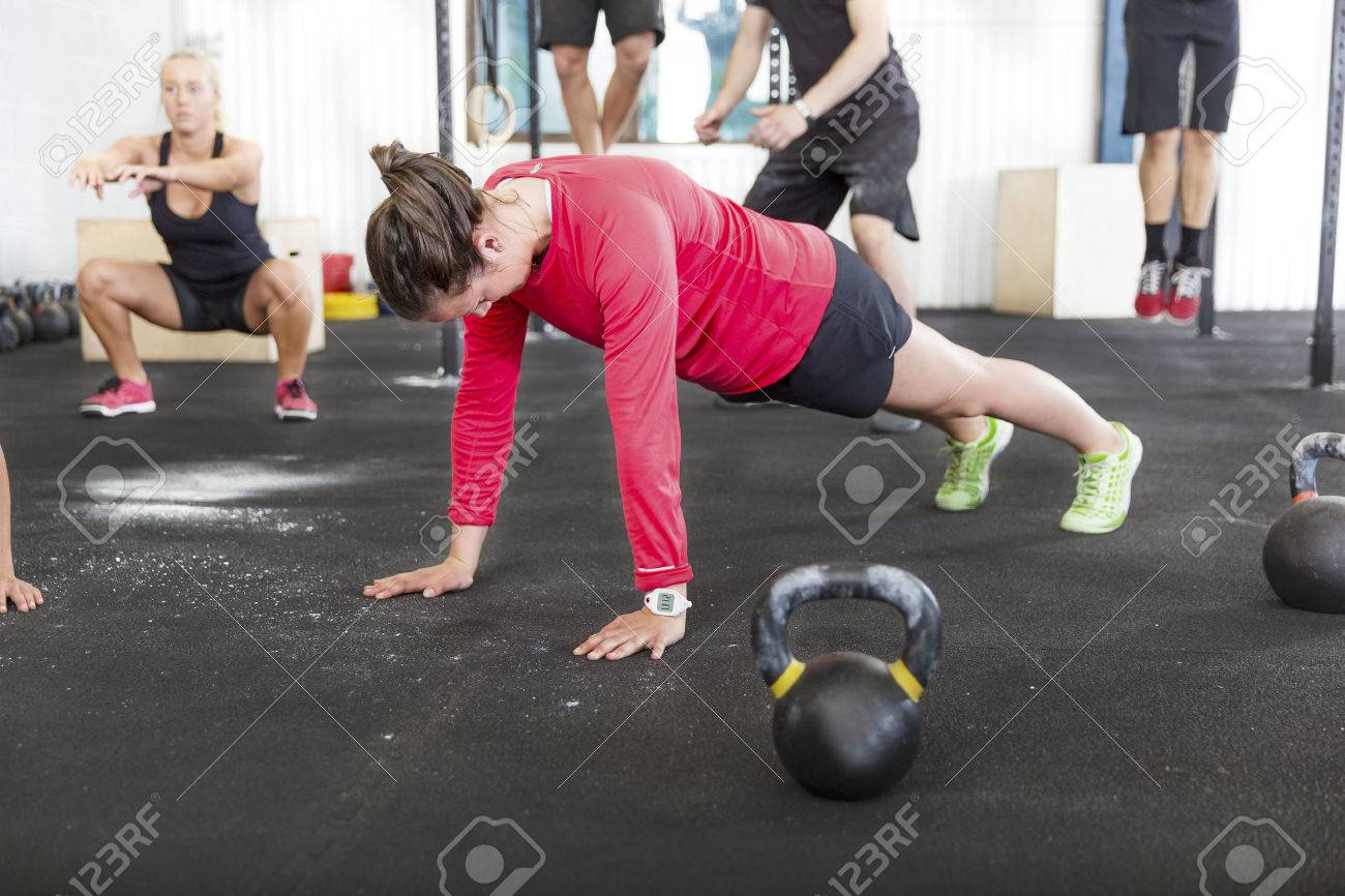 Workout group trains different exercises Stock Photo - 31992478